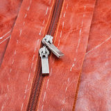 Metal runners of zipper on hide clothing Royalty Free Stock Photo