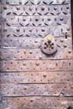 Metal  rust door with a forged pattern with rings for knocking. Metal rust door with forged pattern with rings for knocking history Jerusalem old city Stock Photos
