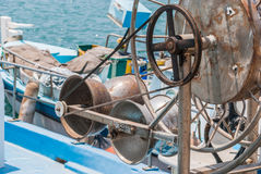 Metal rusted hose reels on fishing boat Royalty Free Stock Image
