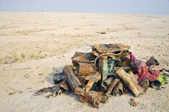 Metal  junk on Ganges river coast sand, India Stock Photo