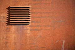 Metal rusted wall with ventilation Stock Photo