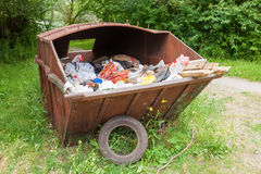 Metal rusty dumpster full of garbage Royalty Free Stock Photos