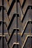 Metal rusty fence. Decorative parts of metal gates. Texture of o. Ld metal background. Geometric pattern. Concept: creative, fence Royalty Free Stock Photo