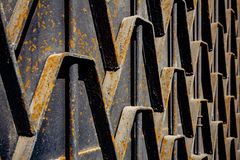 Metal rusty fence. Decorative parts of metal gates. Texture of o. Ld metal background. Geometric pattern. Concept: creative, fence Royalty Free Stock Photos
