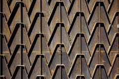 Metal rusty fence. Decorative parts of metal gates. Texture of o. Ld metal background. Geometric pattern. Concept: creative, fence Royalty Free Stock Image