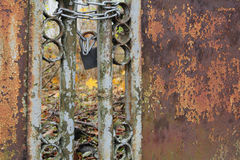 Metal rusty fence with lock. Metal rusty fence with lock near the brewery Stock Image