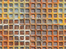 Metal rusty surface with a square shape. Seamless grunge texture. Metal rusty surface with a square shape Stock Photography