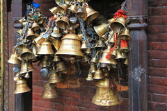 Metal sacrificial bells at Kumbeshwar Temple, Nepal Stock Photography