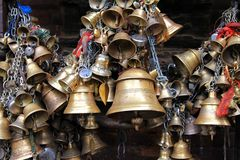 Metal sacrificial bells at Kumbeshwar Temple, Nepal Stock Image