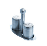 Metal salt and pepper shakers on stand Stock Photo