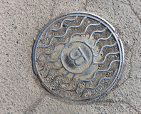 Metal Sanitary sewer manhole cover. Top view Royalty Free Stock Image