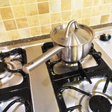 Metal saucepan on gas stove Royalty Free Stock Photos