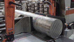 Metal saw cuts steel rod. Process of cutting large steel rod - using metal saw and water for cooling stock footage