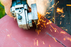 Metal sawing close up with angle grinder Royalty Free Stock Photo