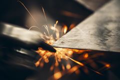 Metal sawing close up. Metal sawing with sparks close up Stock Image