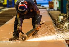 Metal sawing in factory Stock Images