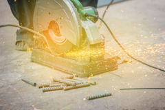Metal sawing sparks while cutting steel Stock Images