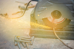 Metal sawing sparks while cutting steel Royalty Free Stock Image