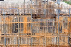 Metal scaffolding by work on dam construction site, Thailand. Royalty Free Stock Photos