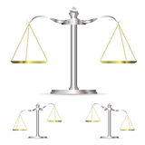 Metal scales. Scales of justice in level up and down position with gold chains Royalty Free Stock Image