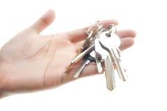 Hand und Schlüssel. Stockbild