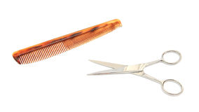 Metal scissor and comp isolated. On white background for barber shop Stock Image