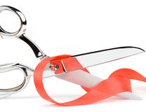 Metal scissors. With red ribbon Stock Images