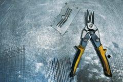 Metal scissors lying on table. Metal scissors working tool lying on table Stock Images
