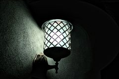 Metal Sconce Light Switched on during Night Time Royalty Free Stock Image