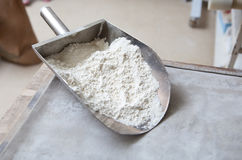 Metal scoop full of flour Royalty Free Stock Photography