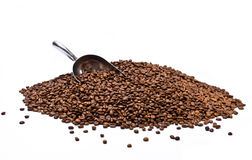Metal scoop partially burried in coffee beans heap Stock Images