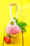 Metal scoop with strawberry icecream Stock Photo