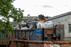 Metal scrap is located in large container stock photo