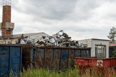 Metal scrap is located in large container royalty free stock photography