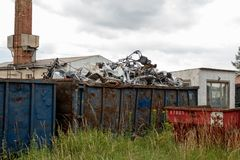 Metal scrap is located in large container stock image
