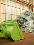 Metal scrap pile and big dozer in recycle factory, Thailand Stock Image