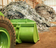Metal scrap pile and big dozer in recycle factory, Thailand Royalty Free Stock Photo