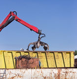 Metal scrap yard with grabber Stock Photo