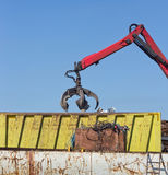 Metal scrap yard with grabber Stock Images