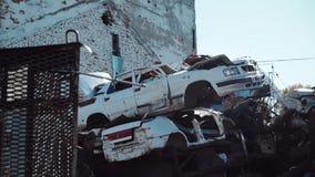 Metal scrap yard for recycling purposes, abandoned rusty car stock video