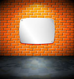 Metal screen on the brick wall Stock Photography
