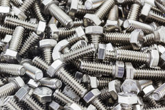 Metal screw and nuts on texture background. Royalty Free Stock Image