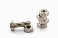 Metal screw and nuts on white background. Royalty Free Stock Photography