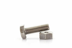 Metal screw and nuts on white background. Stock Photography