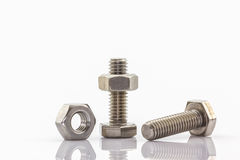 Metal screw and nuts on white background. Stock Images