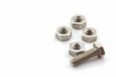 Metal screw and nuts on white background. Royalty Free Stock Photo
