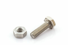 Metal screw and nuts on white background. Royalty Free Stock Photos