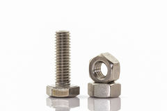 Metal screw and nuts on white background. Royalty Free Stock Images