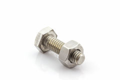 Metal screw and nuts on white background. Stock Image