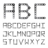 Metal screwed alphabet font Royalty Free Stock Images